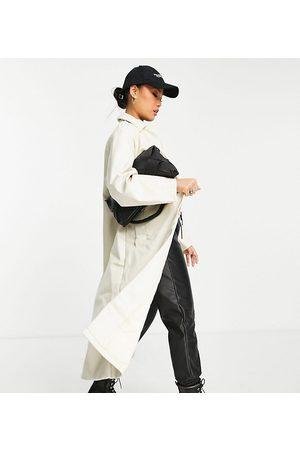 ASOS Petite ASOS DESIGN Petite 90s faux leather trench coat in cream