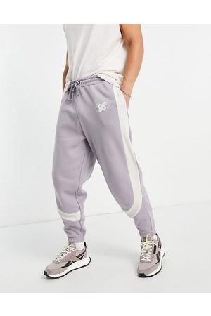 ASOS DESIGN Men Joggers - Oversized joggers in grey colour block with rib details