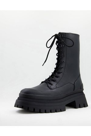 ASOS DESIGN Lace up calf boot on triple stacked sole with contrast stitching detail in faux leather