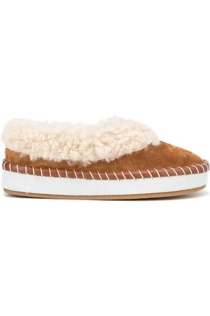 Tory Burch Logo-embossed shearling slippers