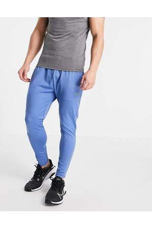 ASOS Men Trousers - Icon super skinny training joggers with quick dry in
