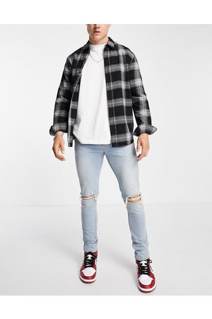 ASOS Men Skinny - Skinny jeans in tinted light wash with knee rips