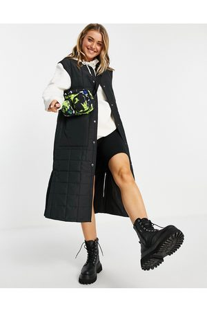 Monki Recycled long quilted vest in