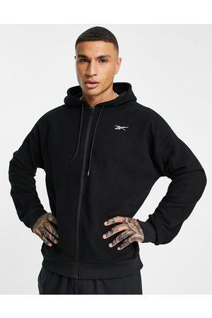 Reebok Training fleece zip thru hoodie with logo in