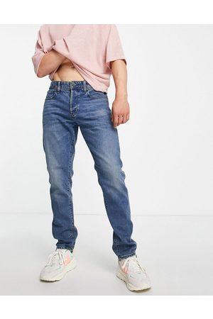 G-Star D-Staq 3D slim fit jeans in mid wash
