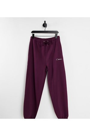 COLLUSION Unisex oversized varsity joggers in vintage burgundy co-ord