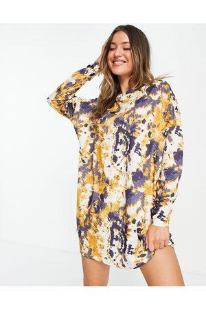 ASOS Oversized mini sweat dress in navy and yellow tie dye print