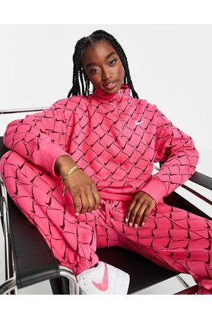 Nike Zip neck sweatshirt in watermelon with all over swoosh print