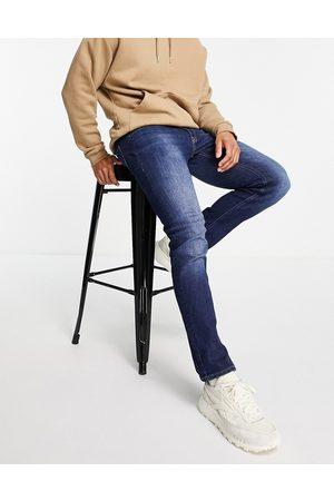 JACK & JONES Intelligence Glenn slim fit jeans in midwash