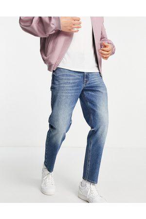 ASOS Classic rigid jeans in dirty dark wash