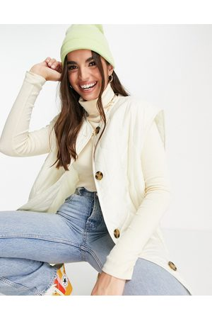 ASOS Quilted collarless gilet in cream