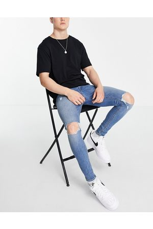 ASOS Spray on jeans with power stretch in vintage mid wash with knee rips