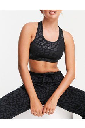 Nike Nike Pro Training tonal leopard print medium support sports bra in