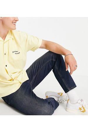 Reclaimed Inspired slim tapered jean in dark wash