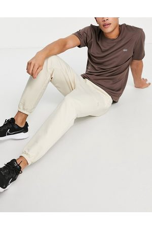 ASOS Icon training jogger with tapered fit in stone-Neutral