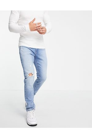 ASOS Skinny jeans in light wash with abrasions