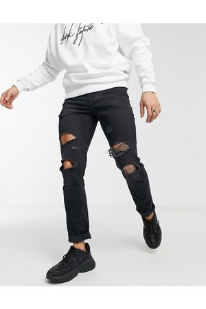 ASOS Stretch slim jeans with 'less thirsty' wash in with rips