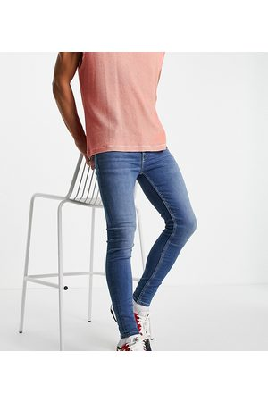 ASOS Men Skinny - Spray on jeans with power stretch in light wash tint