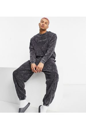ASOS Relaxed jogger in charcoal wash with logo
