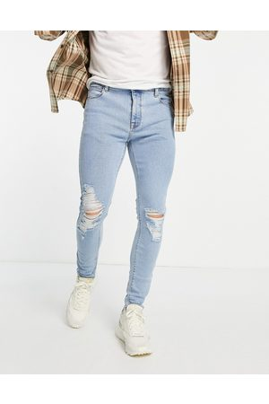 ASOS Spray on 'vintage look' jeans with powerstretch in light wash with knee rips