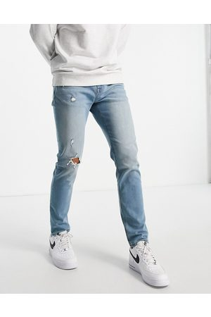 ASOS Skinny jeans in tinted light wash with abrasions