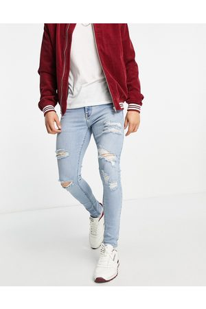 ASOS Men Skinny - Spray on 'vintage look' jeans with powerstretch in light wash with heavy rips