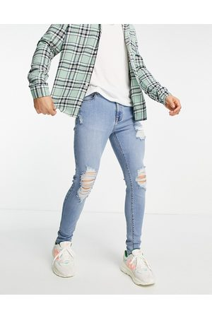 ASOS Spray on 'vintage look' jeans with powerstretch in mid wash with heavy rips