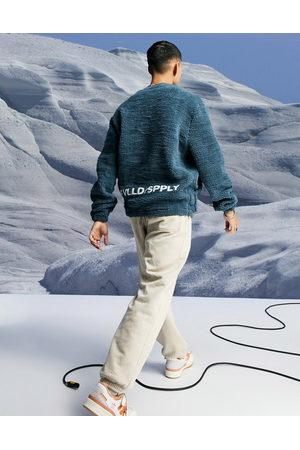 ASOS Men Sweatshirts - Oversized teddy borg sweatshirt with logo embroidery-Navy