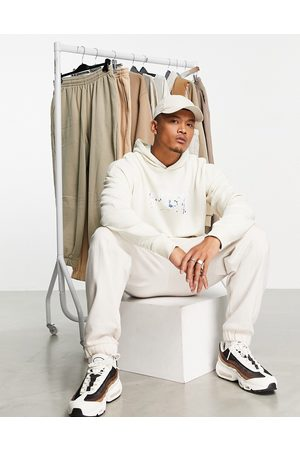 The Couture Club Men Sweatshirts - Flying eagle oversized hoodie in cream