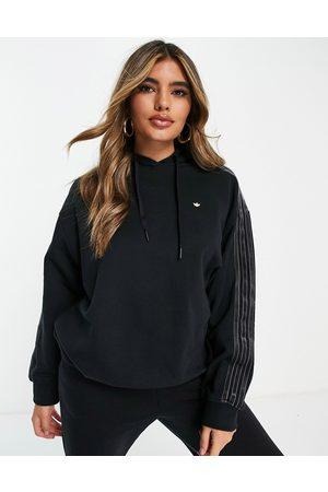 adidas Women Sweatshirts - Hoodie with tonal three stripes in black