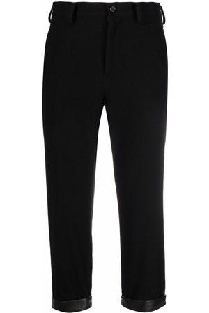 YOHJI YAMAMOTO Women Leather Pants - Cropped leather-cuff trousers