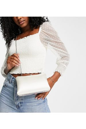 True Decadence Exclusive structured clutch bag with metal top handle in off