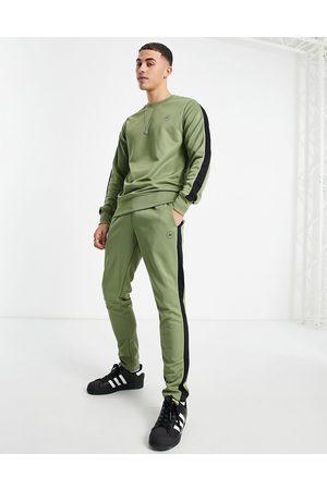 JACK & JONES Core hoodie tracksuit with arm logo in khaki
