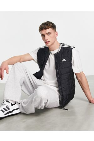 adidas Adidas Outdoor lite puffer gilet with three stripes in