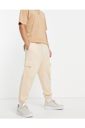 ASOS Men Sets - Co-ord waffle wide leg cargo joggers in -Neutral