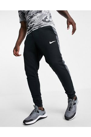 Nike Men Joggers - Camo tapered joggers in