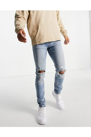 ASOS Skinny jeans in mid wash with knee rips