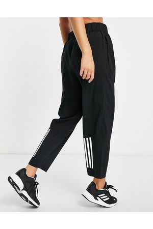 adidas Adidas Training joggers with branded trim in