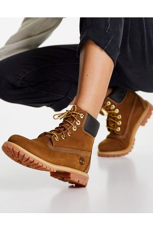 Timberland 6 inch premium lace up flat boots in rust