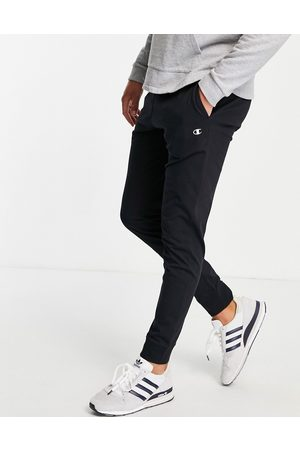 Champion Small logo tracksuit bottoms in black-Navy