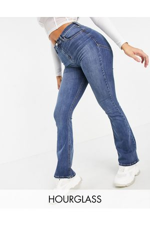 ASOS High rise 'lift and contour' flare jeans in midwash