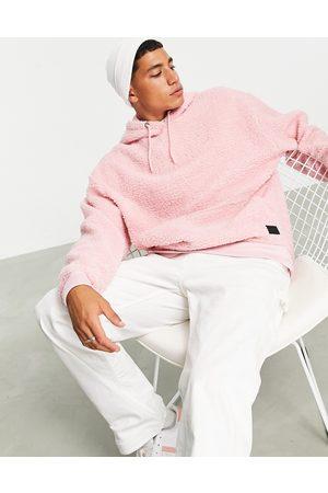 ASOS Men Sweatshirts - Oversized hoodie in teddy borg with badge