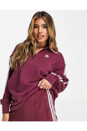 adidas Adicolor three stripe quarter zip sweatshirt in crimson