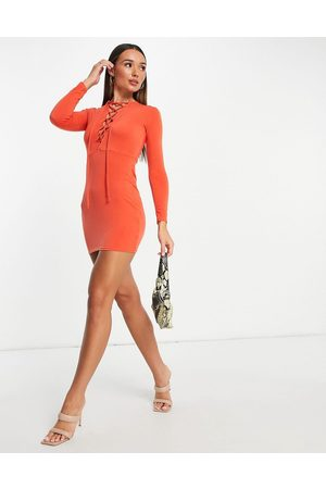Flounce London Bodycon mini dress with lace up front detail in burnt
