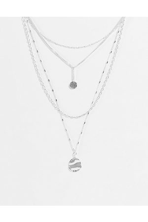 Accessorize Layering necklaces in