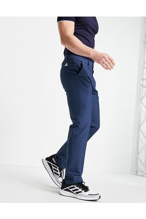 adidas Ultimate 4 way stretch trousers in navy