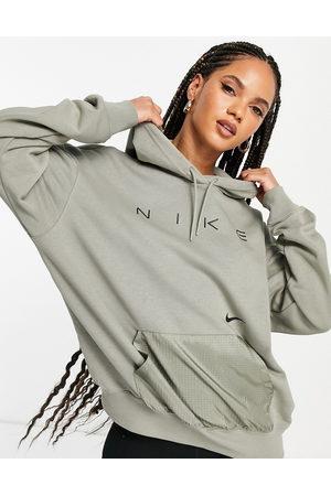 Nike Oversized fleece hoodie in dark with logo