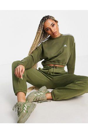 adidas Adidas Training cropped sweatshirt with three stripe in khaki