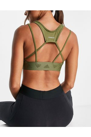 adidas Adidas Training light support sports bra with cut out detail in khaki