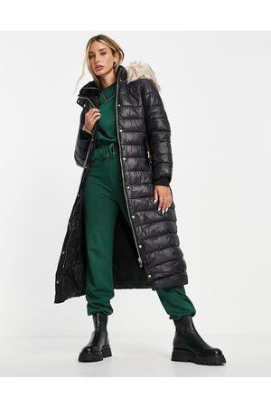 River Island Women Jackets - Longline padded jacket with faux fur hood in
